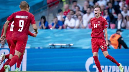 Denmark's Mikkel Damsgaard (right) celebrates scoring their side's first goal of the game during the
