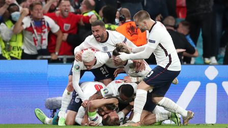 England's Harry Kane is mobbed by team-mates after scoring their side's second goal of the game in e