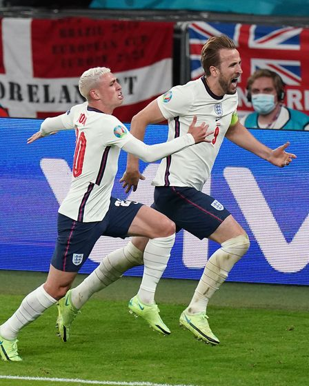 England's Harry Kane celebrates scoring their side's second goal of the game with Phil Foden during