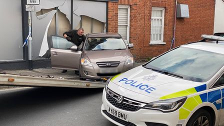 Police remain at the scene of the crash at Pizza Hut in Foxhall Road, Ipswich.
