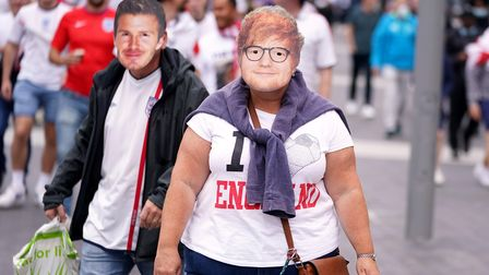 England fans sporting facemasks of Ed Sheeran and David Beckham outside Wembley Stadium ahead of the