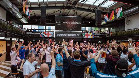 England fans get into the spirit of the Euro 2020 semi-final match at Boxpark Wembley