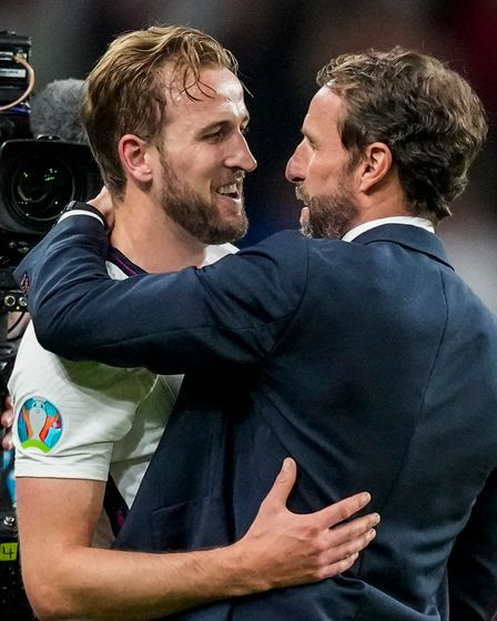 England's manager Gareth Southgate, right, and England's Harry Kane celebrate after winning the Euro