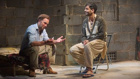 Daniel Lapaine and Sid Sagar in The Invisible Hand by Ayad Akhtar at the Kiln Theatre. Directed by