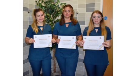 Students Tia Copland, Molly Hooper and Rhiannon Lamb with their certificates after training at Suffolk New College
