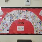 """A red notice board with the word """"Pride"""" in the middle - Forest Hall School, Stansted"""