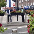 Cllr Howard and Cllr Rai with the newly-installed planters