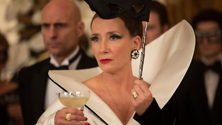 Mark Strong as John the Valet and Emma Thompson as the Baroness in Disney's Cruella.
