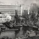 Grain being discharged by elevators into barges at the Co-Op Mills at Royal Victoria Dock 1954PLA Co