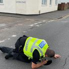 Police checking the sink hole in Victoria Road, Wisbech.
