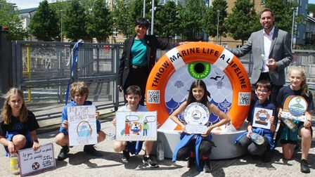 Fazilette Khan, Ben Smith and pupils from Portishead Primary School at the official opening of the marine conservation bin.