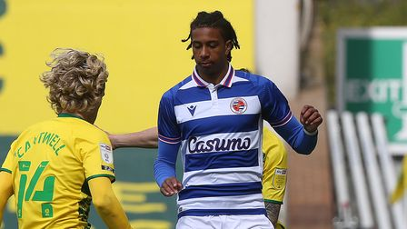 Todd Cantwell of Norwich, Michael Olise of Reading and Xavier Quintilla of Norwich in action during