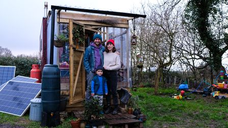 Devon-based musician Poco Drum with his family outside their tiny house.