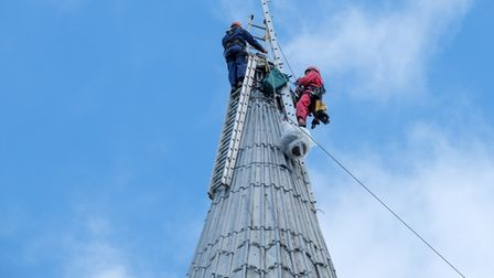 Climbing engineers install the new weathervane at St Jude's