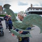 Engineer Robin Sims carries the new weathervane for St Jude's Church in Hampstead Garden Suburb