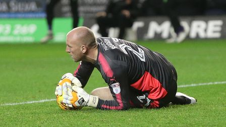 John Ruddy of Wolverhampton Wanderers saves a shot by Marley Watkins of Norwich during the Sky Bet C
