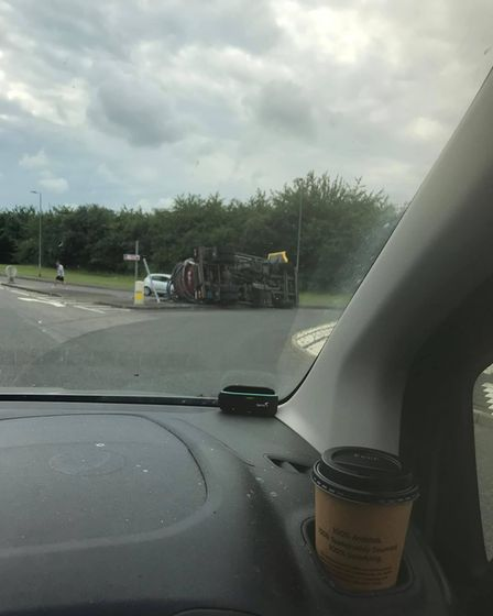 A photo through a windscreen: Oil tanker toppled over at Little Chesterford, Essex