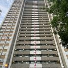 Three friends spent nearly two hours tying St George flags onto each floor of Peregrine House in Hall Street, Finsbury