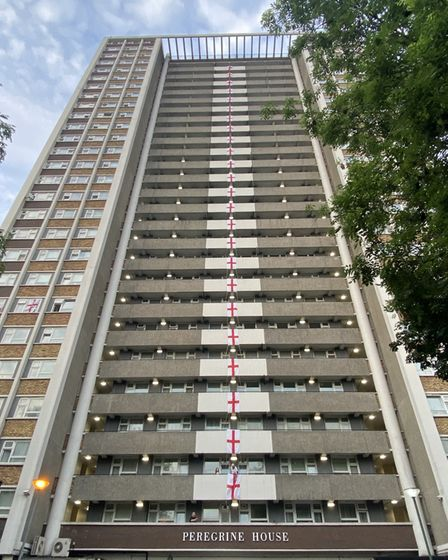 Football mad fans in Finsbury have adorned their 26-storey block of flats with huge flags of St George