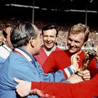 File photo dated 30-07-1966 of Sir Alf Ramsey, Bobby Moore and Nobby Stiles with the World Cup 1966