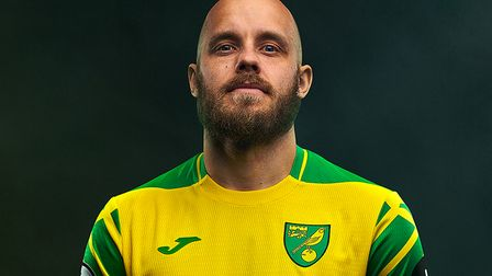 Teemu Pukki poses in the new Norwich City home kit for 2021/22
