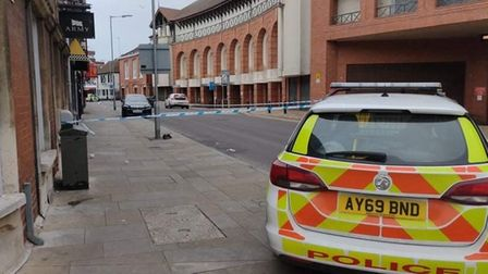 Police in Falcon Street, Ipswich, which has been cordoned off