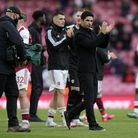 Arsenal manager Mikel Arteta applauds fans after the Premier League match at the Emirates Stadium, L
