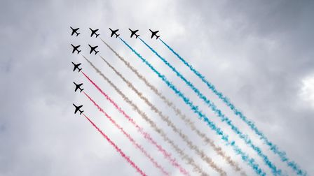 The Red Arrows perform a flypast during Armed Forces' Day at the National Memorial Arboretum
