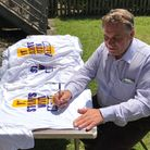 MP Neil Parish signs T-shirts for Honiton Scouts