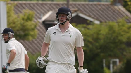 Ed Wharton in action for Reed Cricket Club