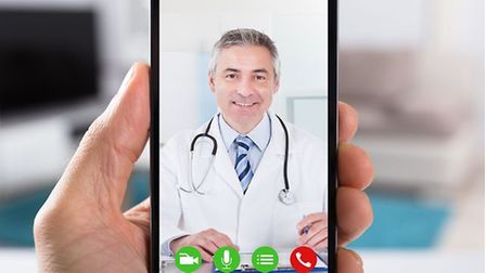 Video calling with a doctor on a smartphone.