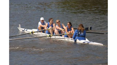 Rowing team in action