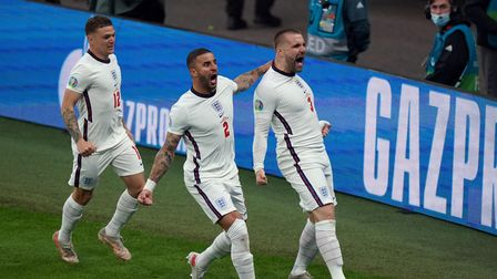 England's Luke Shaw celebrates scoring the opening goal with Kyle Walker and Kieran Trippier during