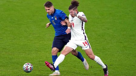 Italy's Ciro Immobile (left) and England's Kalvin Phillips (right) battle for the ball during the UE