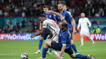 Italy's Giorgio Chiellini (right) tackles England's Raheem Sterling during the UEFA Euro 2020 Final