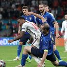 Italy's Giorgio Chiellini (right) tackles England's Raheem Sterling during the UEFA Euro 2020 Final at Wembley Stadium