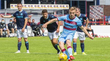 West Ham United's Jarrod Bowen scores the fourth goal of the game from the penalty spot during the p