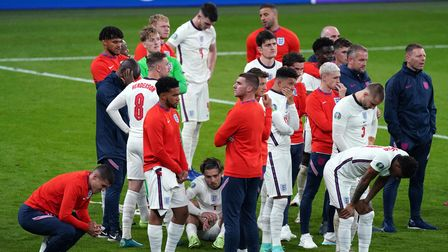 England players stand dejected following the UEFA Euro 2020 Final at Wembley Stadium, London. Pictur