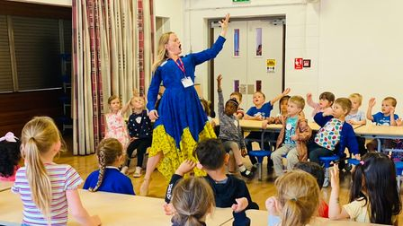 Acclaimed soprano Lizzie Holmes sings to Clover Hill VA Infant School pupils.