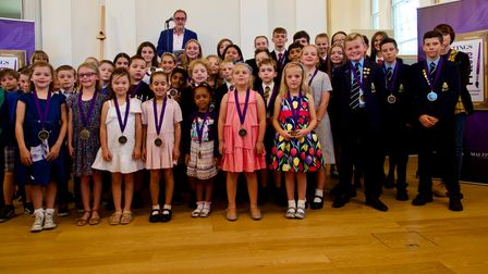 Past winners of the Maltings Art Prize with centre manager Phil Corrigan.