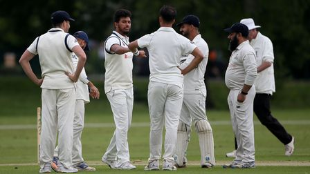 Wanstead players celebrate the wicket of R Saunders during Hornchurch CC vs Wanstead and Snaresbrook