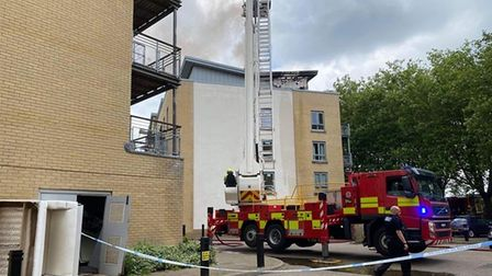 Firefighters tackle the fire at the high-rise block of flats in Ipswich