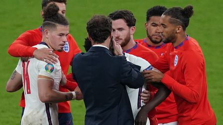 England's Bukayo Saka is consoled by manager Gareth Southgate after missing during the penalty shoot