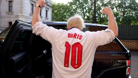 Boris Johnson, wearing an England top over his shirt, heads to Wembley for the semi-final against Denmark