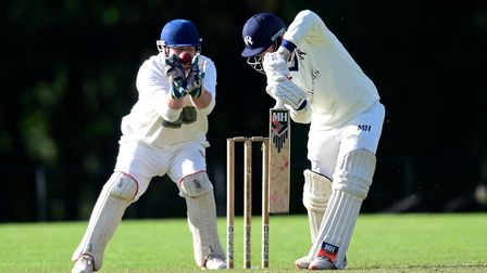 Jack Dart of Heathcoat CC plays a shot as the ball hits Tim Piper, Wicketkeeper of Exmouth CC in the