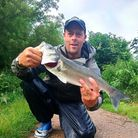 Damion Fryer with a Surprise River Otter Bass