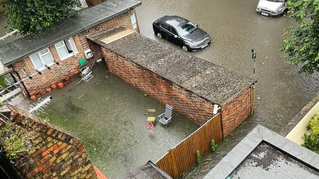 Gardens underwater in Goldhurst Terrace, South Hampstead, after flash flooding
