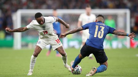 England's Raheem Sterling (left) and Italy's Emerson battle for the ball during the UEFA Euro 2020 F