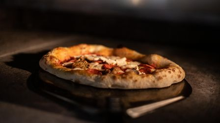 Fresh pizza in the oven at Sourdough St in Ipswich