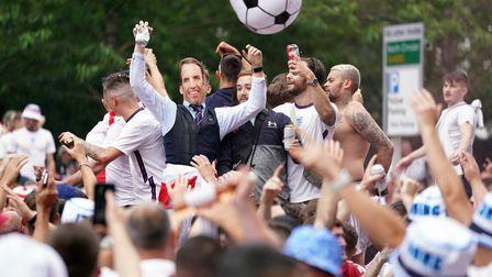 England fans outside the ground ahead of the UEFA Euro 2020 Final at Wembley Stadium, London. Pictur